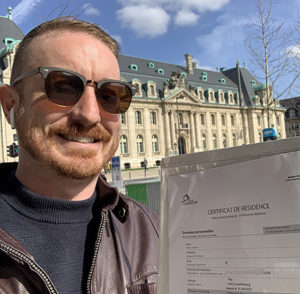 LuxCitizenship founder with residency certificate